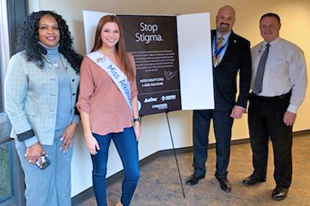 Miss Arkansas 2019 Darynne Dahlem takes the Stop The Stigma! pledge. (From left, DHS Prescription Drug Overdose Project Director Helenia Valencino, Dahlem, Arkansas Drug Director Kirk Lane, and Jay Hill Director of the Division of Aging, Adult, & Behavioral Health Services